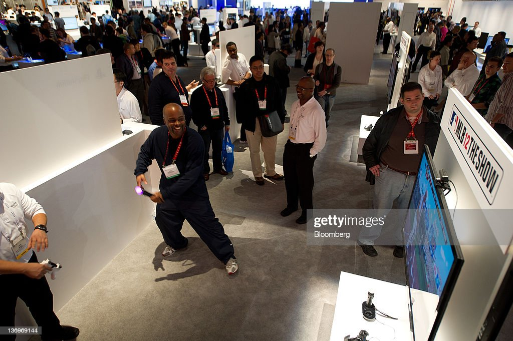 An attendee plays a Sony Corp. Playstation game at the Sony Corp. booth at the International Consumer Electronics Show (CES) in Las Vegas, Nevada, U.S., on Friday, Jan. 13, 2012. The 2012 CES trade show, which runs through Jan 13, features more than 2,700 global technology companies presenting consumer tech products and is expected to draw over 140,000 attendees. Photographer: David Paul Morris/Bloomberg via Getty Images
