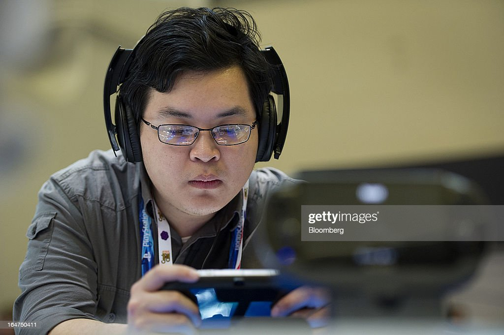 An attendee plays a video game at the Sony Corp. booth at the Game Developers Conference 2013 in San Francisco, California, U.S., on Wednesday, March 27, 2013. With over 22,500 attendees, the Game Developers Conference is the world's largest and longest-running professionals-only game industry event. Photographer: David Paul Morris/Bloomberg via Getty Images