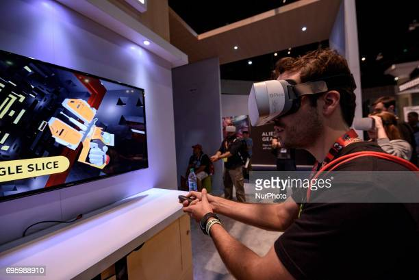 An attendee plays a video game using virtual reality during E3 Electronic Entertainment Expo on June 13 2017 in Los Angeles California E3 is the...