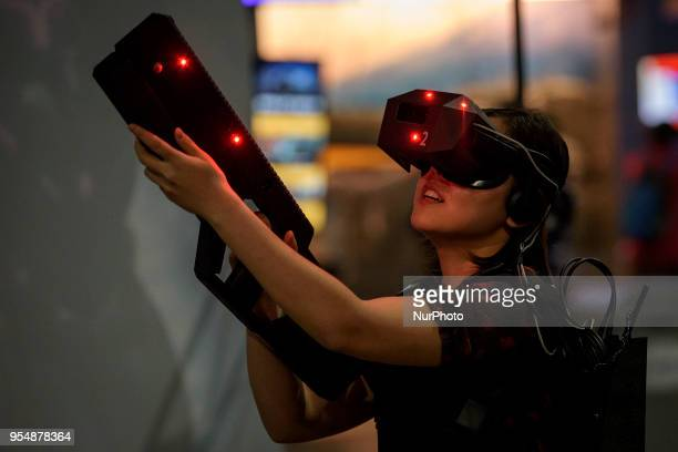 An attendee plays a virtual realty game at VRLA Virtual Reality Los Angeles expo in Los Angeles California on May 4 2018