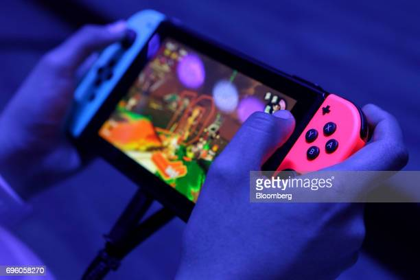 An attendee plays on a Nintendo Co Switch video game console during the E3 Electronic Entertainment Expo in Los Angeles California US on Wednesday...