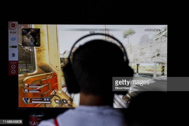 An attendee plays the Apex Legends video game during an Electronic Arts Inc event ahead of the E3 Electronic Entertainment Expo in Los Angeles...