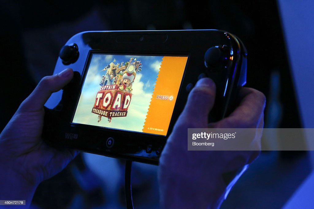 An attendee plays the Toad Treasure Tracker video game on a Nintendo Co. Wii U console during the E3 Electronic Entertainment Expo in Los Angeles, California, U.S., on Wednesday, June 11, 2014. E3, a trade show for computer and video games, draws professionals to experience the future of interactive entertainment as well as to see new technologies and never-before-seen products. Photographer: Patrick T. Fallon/Bloomberg via Getty Images