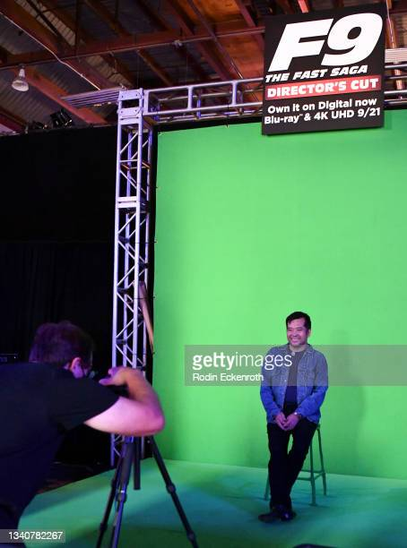 An attendee poses for a portrait at green screen photo op at the F9 Fest event on the Universal Studios backlot celebrating F9: The Fast Saga on...