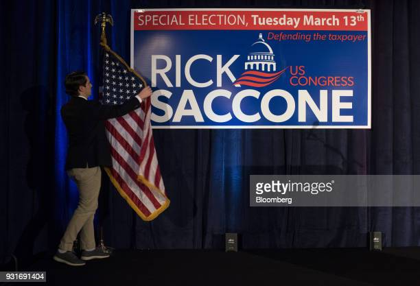 An attendee prepares a flag on a stage ahead of an election night rally with Rick Saccone Republican candidate for the US House of Representatives...