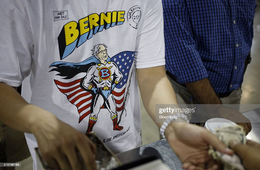 An attendee purchases concessions while waiting for the start of a campaign event for Senator Bernie Sanders, an independent from Vermont and 2016 Democratic presidential candidate, not pictured, in Phoenix, Arizona, U.S., on Tuesday, March 15, 2016. In Democratic forums, Sanders and Hillary Clinton argue that deportations are ripping apart hard-working undocumented people who are merely trying to make a good life for their families, and that the president must show them mercy, even if it means stretching the limits of the law. Photographer: Luke Sharrett/Bloomberg via Getty Images