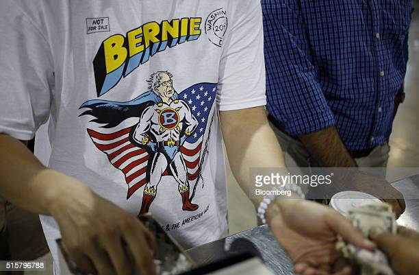 An attendee purchases concessions while waiting for the start of a campaign event for Senator Bernie Sanders an independent from Vermont and 2016...