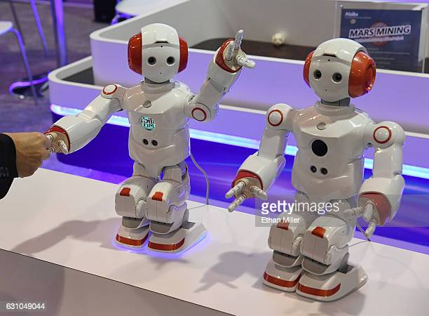 An attendee reaches out to an Abilix Everest 5 educational robot at CES 2017 at the Sands Expo and Convention Center on January 5 2017 in Las Vegas...