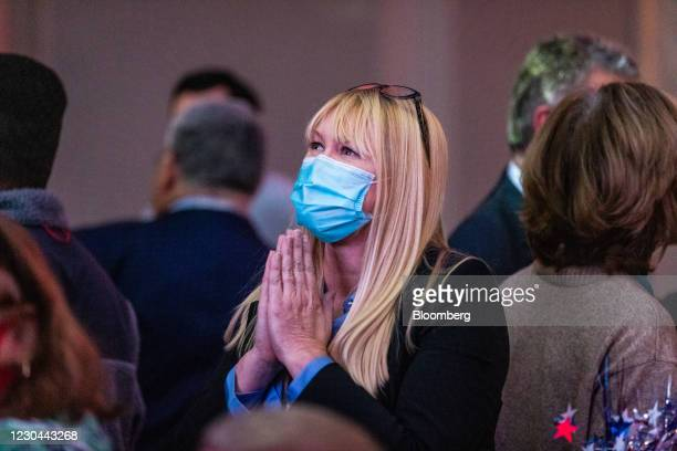 An attendee reacts as results come in during a GOP election night party in Atlanta, Georgia, U.S., on Tuesday, Jan. 5, 2021. DemocratRaphael...