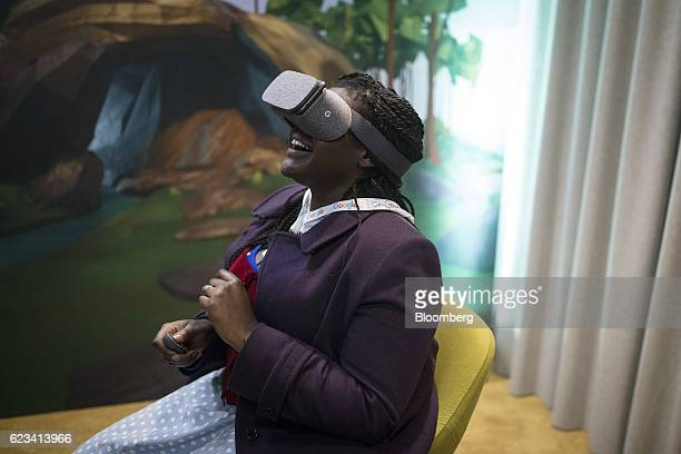 An attendee reacts as she uses the Google Inc Daydream View virtual reality headset during an event at Google's Kings Cross office in London UK on...