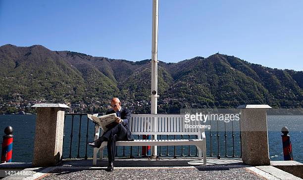 An attendee reads a copy of La Stampa newspaper during a break in sessions at the Ambrosetti Workshop in Cernobbio, near Como, Italy, on Friday,...