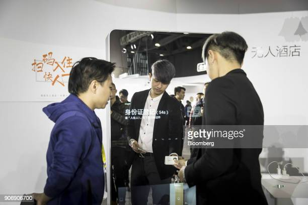 An attendee scans a card during a demonstration of an automated hotel checkin service at Tencent Holdings Ltd's WeChat Open Class Pro conference in...