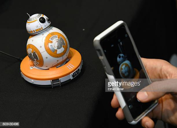 An attendee shoots images of Sphero's BB8 technical prototype during a press event for CES 2016 at the Mandalay Bay Convention Center on January 4...