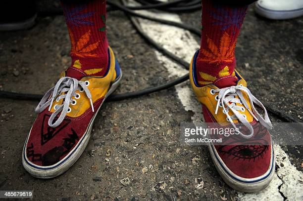 An attendee shows off his marijuana themed socks during the High Times Cannabis Cup at Denver Mart in Denver Colorado on April 19 2014 Event...