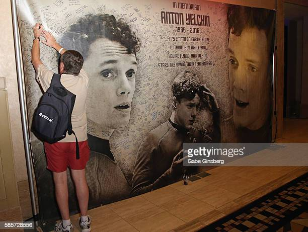 An attendee signs a memorial display for actor Anton Yelchin during the 15th annual official Star Trek convention at the Rio Hotel Casino on August 3...