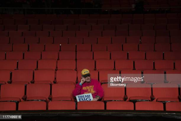 An attendee sits after listening to Senator Elizabeth Warren, a Democrat from Massachusetts and 2020 presidential candidate, not pictured, speak...