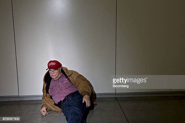 An attendee sits as he waits for U.S. President-elect Donald Trump, not pictured, to arrive during an event in West Allis, Wisconsin, U.S., on...