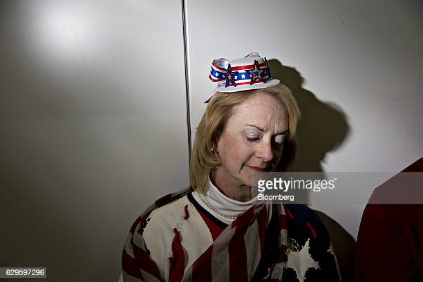 An attendee sits as she waits for U.S. President-elect Donald Trump, not pictured, to arrive during an event in West Allis, Wisconsin, U.S., on...