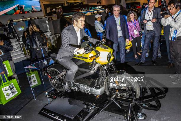 An attendee sits on a HarleyDavidson Inc LiveWire electric motorcycle on display at the 2019 Consumer Electronics Show in Las Vegas Nevada US on...