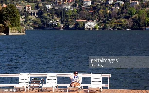 An attendee sits on a sun lounger during a break in sessions at the Ambrosetti Workshop in Cernobbio, near Como, Italy, on Friday, March 30, 2012....