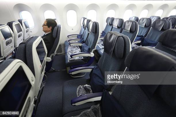 An attendee sits while inspecting the interior of an All Nippon Airways Co operated Boeing Co 7878 during a media event at Benito Juarez...