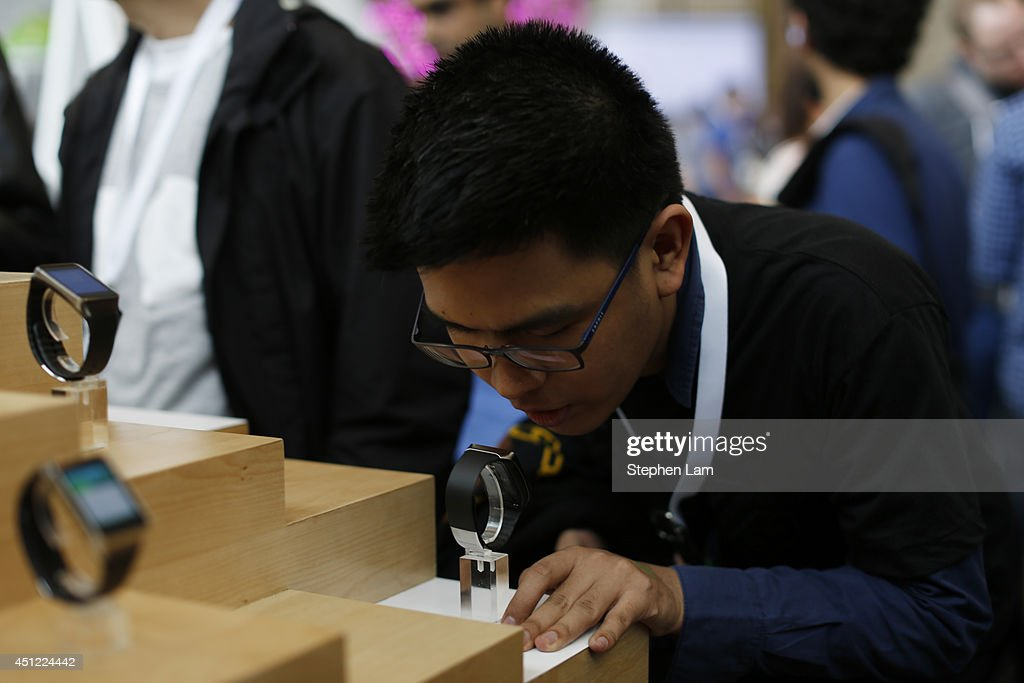 An Attendee speaks into a Samsung Gear Live watch during the Google I/O Developers Conference at Moscone Center on June 25, 2014 in San Francisco, California. The seventh annual Google I/O Developers conference is expected to draw thousands through June 26.