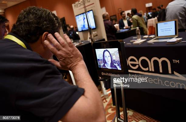 An attendee speaks with an exhibitor through the Suitable Technologies Beam Smart Presence System during ShowStoppers at the 2016 Consumer...