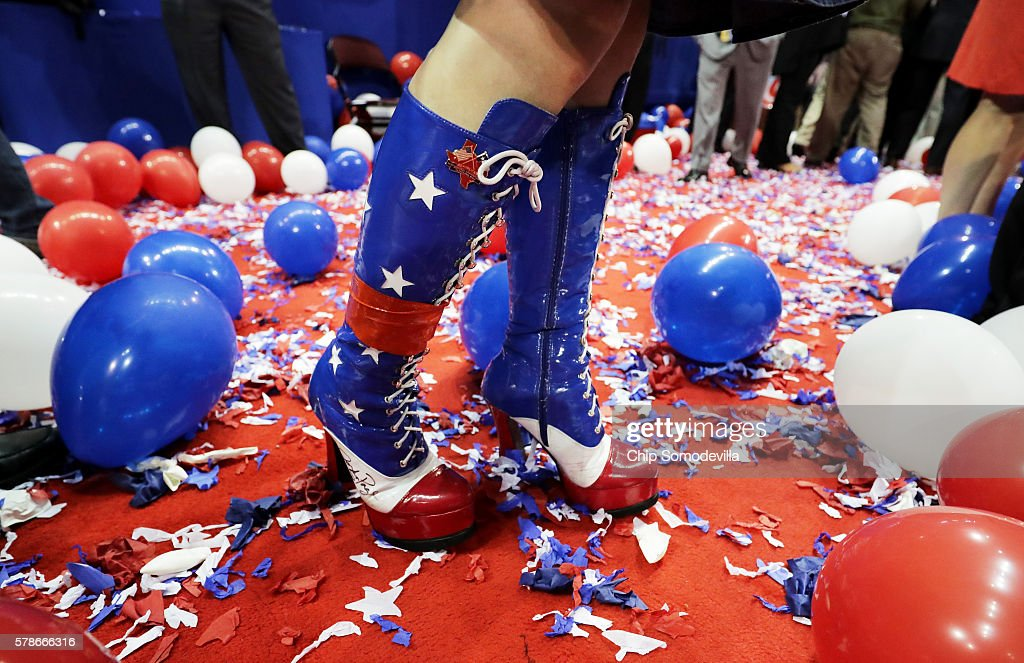 An attendee stands amongst balloons at the end of the fourth day of the Republican National Convention on July 21, 2016 at the Quicken Loans Arena in Cleveland, Ohio. Republican presidential candidate Donald Trump received the number of votes needed to secure the party's nomination. An estimated 50,000 people are expected in Cleveland, including hundreds of protesters and members of the media. The four-day Republican National Convention kicked off on July 18.