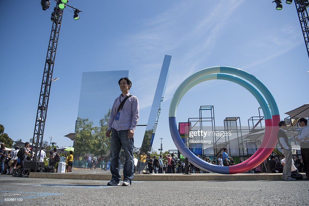 An attendee stands in front of a Google Inc., I/O statue during the Google I/O Annual Developers Conference in Mountain View, California, U.S., on Wednesday, May 18, 2016. Google unveiled a new video calling application named Duo that will compete with Apple Inc.'s FaceTime. Photographer: David Paul Morris/Bloomberg via Getty Images