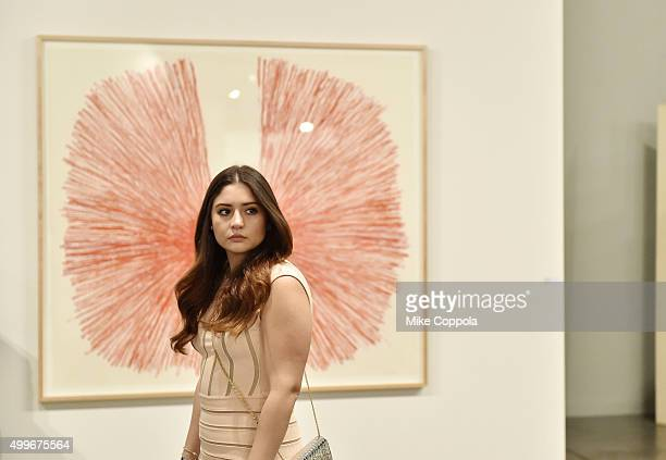 An attendee stands in front of 'Red Vetruvian Man III' by artist William Anastasi from Galerie Jocelyn Wolf at the Art Basel Miami Beach VIP Preview...
