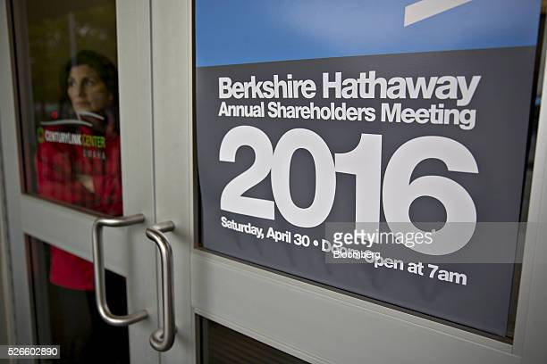 An attendee stands inside an entrance door to the Berkshire Hathaway Inc annual shareholders meeting in Omaha Nebraska US on Saturday April 30 2016...