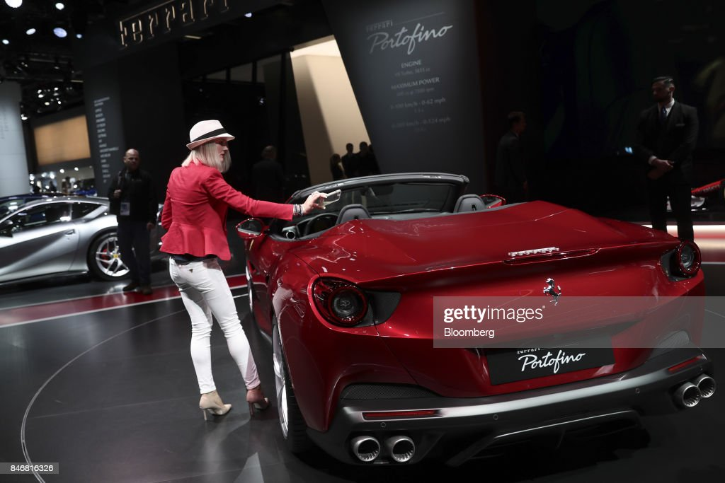 An attendee takes a photo of a Ferrari NV Portofino entry-level supercar as it sits on display during the second media preview day of the IAA Frankfurt Motor Show in Frankfurt, Germany, on Wednesday, Sept. 13, 2017. The 67th IAA opens to the public on Sept. 14 and features must-have vehicles and motoring technology from over 1,000 exhibitors in a space equivalent to 33 soccer fields. Photographer: Simon Dawson/Bloomberg via Getty Images