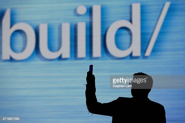An attendee takes a photograph of a sign during the 2015 Microsoft Build Conference on April 30 2015 at Moscone Center in San Francisco California...