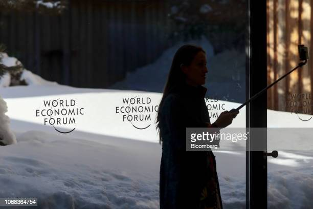 An attendee takes a selfie photograph in the Congress Center on the closing day of the World Economic Forum in Davos Switzerland on Friday Jan 25...