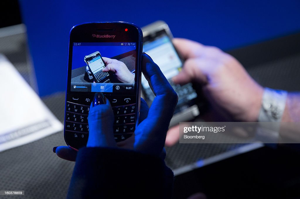 An attendee takes a video of the new BlackBerry 10 with an older BlackBerry during the device's launch in New York, U.S., on Wednesday, Jan. 30, 2013. Research In Motion Ltd. (RIM), taking the name of its best-known product, will now be known simply as BlackBerry, part of a comeback plan that includes unveiling a redesigned line of smartphones today. Photographer: Scott Eells/Bloomberg via Getty Images