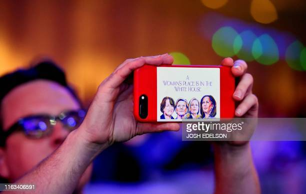 An attendee takes a video with a cellphone during the Democratic National Committee's summer meeting in San Francisco California on August 23 2019