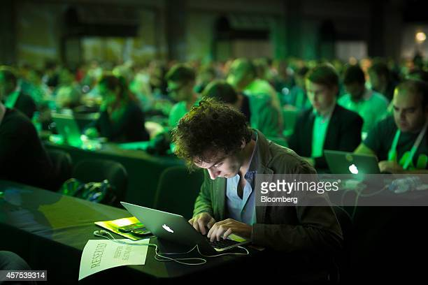 An attendee takes notes on an Apple Inc laptop computer while attending a panel session at the Disrupt Europe 2014 conference in London UK on Monday...