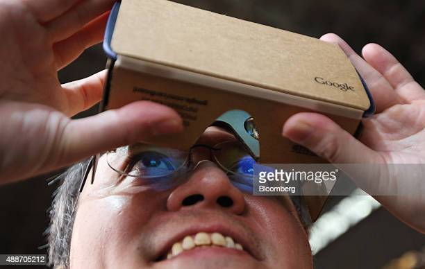 An attendee tries a Google Inc Cardboard virtual reality headset at the Tokyo Game Show 2015 at Makuhari Messe in Chiba Japan on Thursday Sept 17...