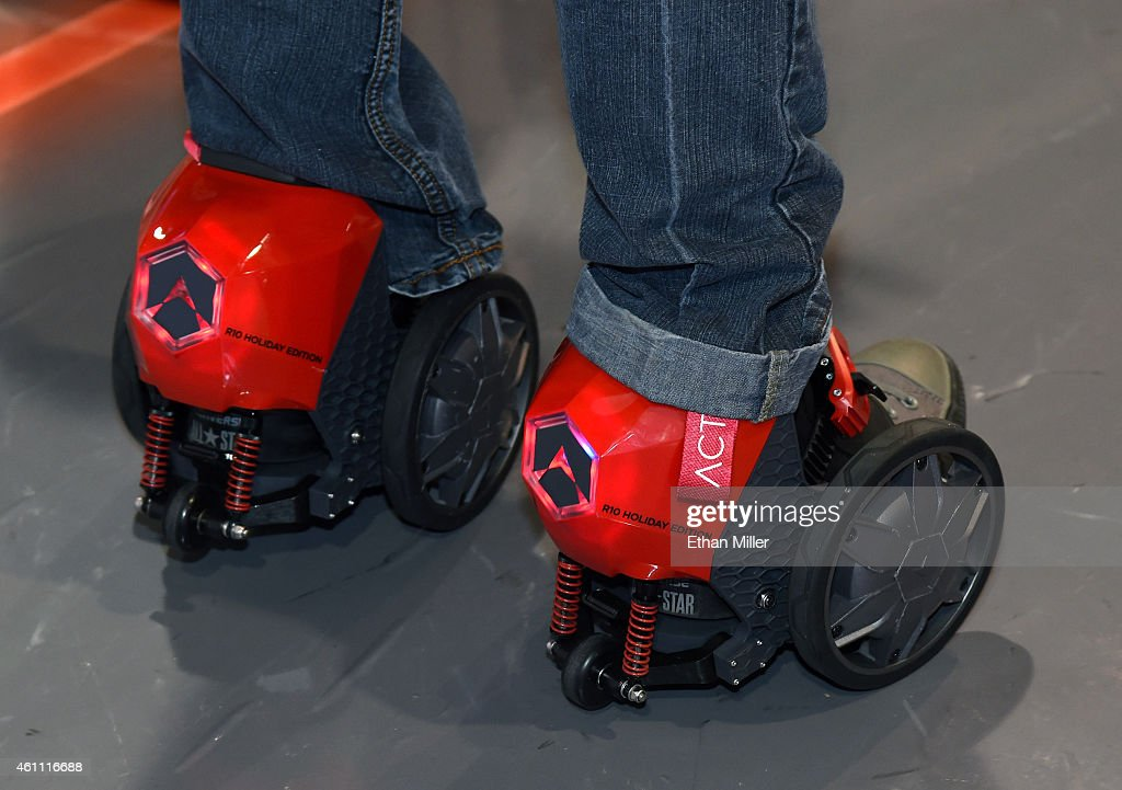 An attendee tries Acton's RocketSkates at the 2015 International CES at the Sands Expo and Convention Center on January 6, 2015 in Las Vegas, Nevada. The motorized skates that you strap to your shoes are powered by Lithium Ion batteries and can go up to 12 mph. CES, the world's largest annual consumer technology trade show, runs through January 9 and is expected to feature 3,600 exhibitors showing off their latest products and services to about 150,000 attendees.