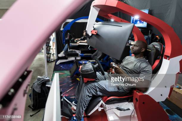 An attendee tries Ingrem's esports cockpit on the business day of the Tokyo Game Show 2019 at Makuhari Messe on September 12, 2019 in Chiba, Japan....