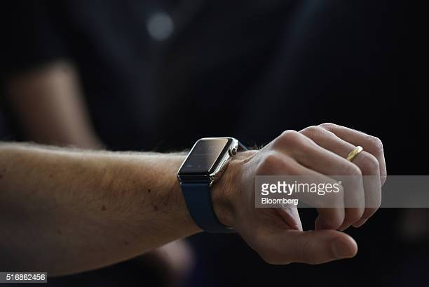 An attendee tries on the Apple Watch after an Apple Inc event in Cupertino California US on Monday March 21 2016 Apple Inc unveiled a new smaller...