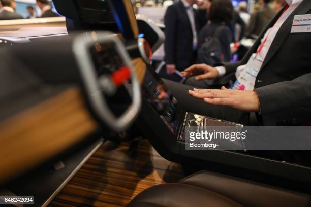 An attendee tries out a haptic gear box in a concept car created by Robert Bosch GmbH on the second day of Mobile World Congress in Barcelona Spain...