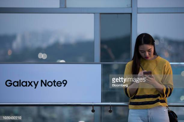 A customer compares a Samsung Electronics Co Galaxy Note 9 smartphone left with a Note 8 smartphone at KT Corp's KT Square flagship store in Seoul...