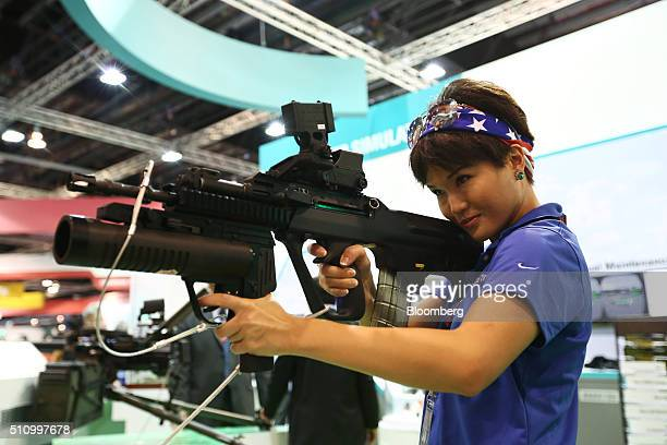 An attendee tries out a STK 556mm Bullpup Multirole Combat Rifle manufactured by Singapore Technologies Kinetics Ltd a division of Singapore...