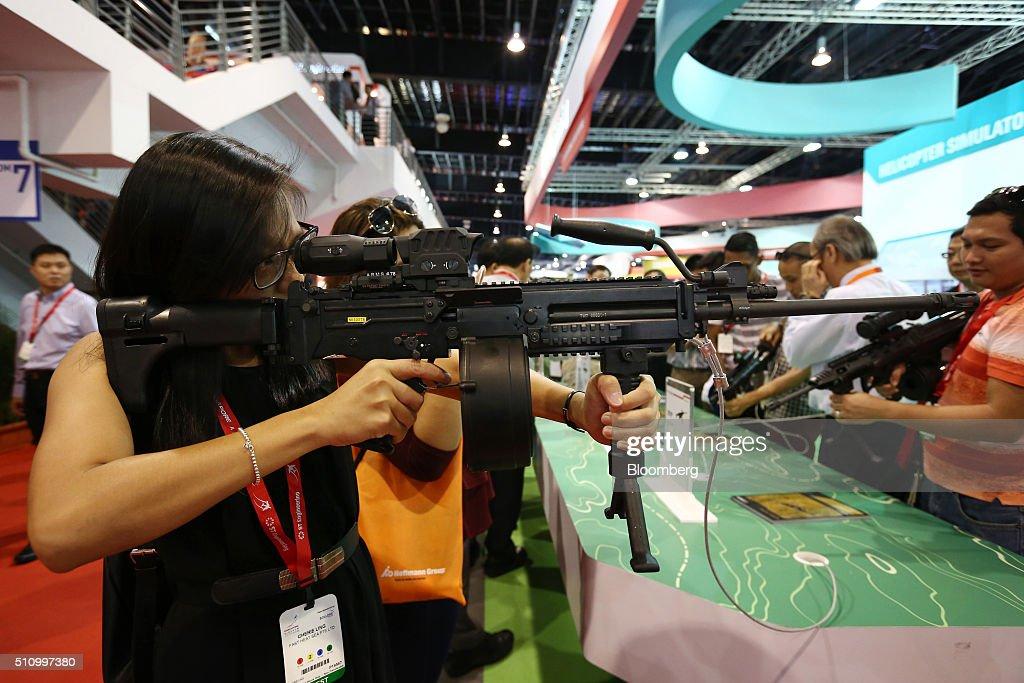 An attendee tries out a U100 Mk8 assault rifle ...