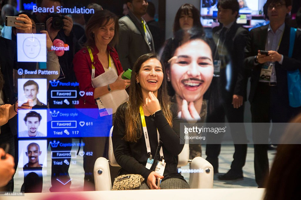 An attendee tries out the beard simulation effect on a Panasonic Corp. Smart Mirror during the 2015 Consumer Electronics Show (CES) in Las Vegas, Nevada, U.S., on Tuesday, Jan. 6, 2015. This year's CES will be packed with a wide array of gadgets such as drones, connected cars, a range of smart home technology designed to make everyday life more convenient and quantum dot televisions, which promise better color and lower electricity use in giant screens. Photographer: Michael Nagle/Bloomberg via Getty Images
