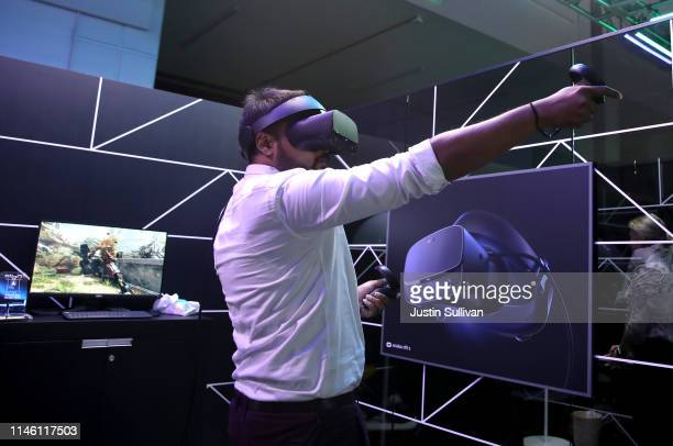 An attendee tries out the Oculus Rift S virtual reality headset during the F8 Facebook Developers conference on April 30 2019 in San Jose California...