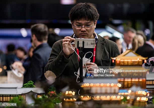 An attendee tries out ZTE's 'AXON' during the second day of the annual Mobile World Congress one of the most important events for mobile technologies...
