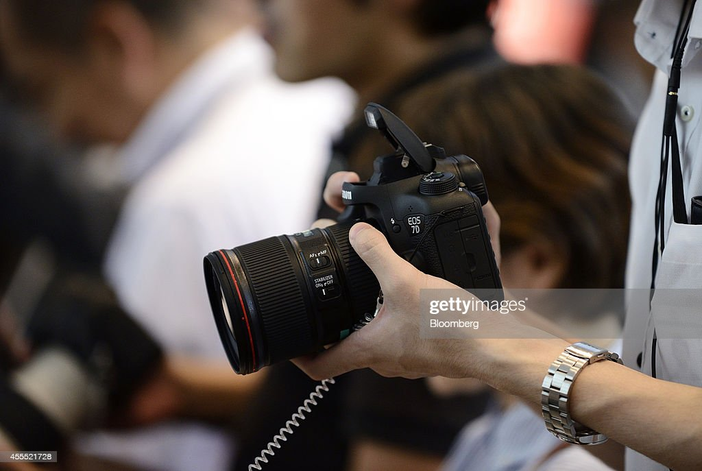 Canon Marketing Japan Inc. President Masami Kawasaki Unveils New Digital Cameras : News Photo
