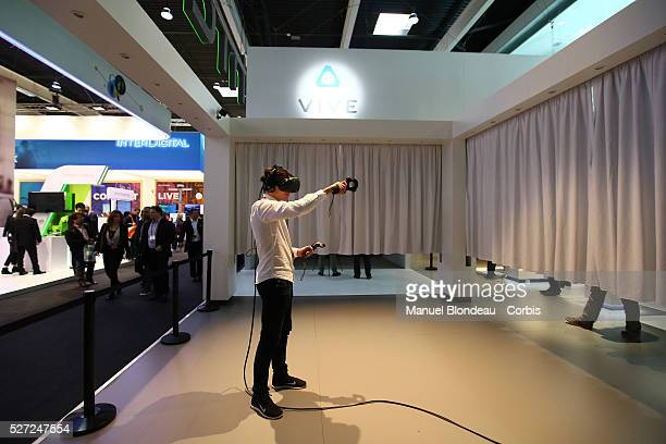 An attendee tries the HTC Vive virtual reality experience at the HTC Corp pavillon during day four of the Mobile World Congress at the Fira Gran Via...